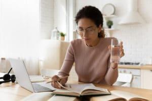 Modern,Day,Teacher.,Focused,Hispanic,Woman,In,Glasses,Read,Study